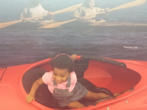 Here she is enjoying the kayak exhibit. It moved which was fun for her but she really wanted mommy to get in...maybe next time!